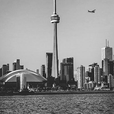 Downtown Toronto with the CN Tower, the Roger's Centre and a passing plane